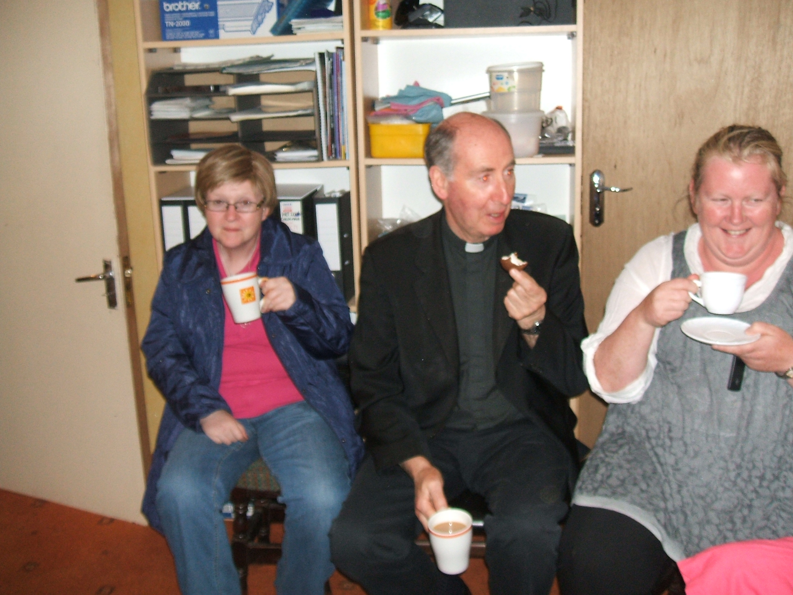 Bishop Brennan enjoying a cuppa and a chat with Mary O' Leary & Jennifer Byrne